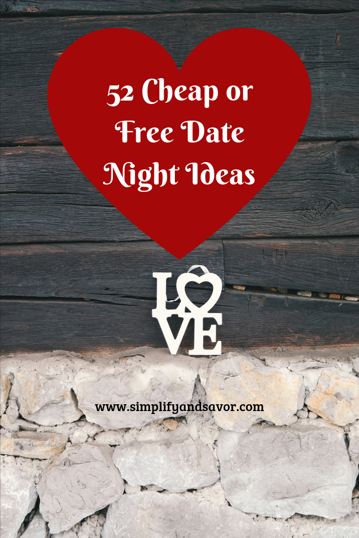 Love sign sitting on a barn foundation. A red heart holds the text 52 Cheap or Free Date Night Ideas