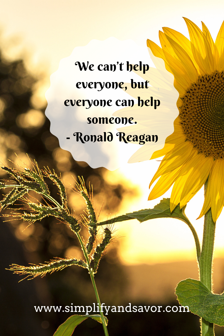 A sunflower with the quote we can't help everyone, but everyone can help someone. - Ronald Reagan