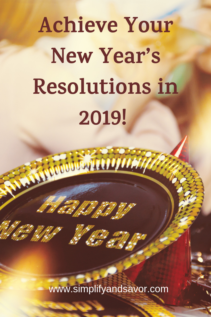 There is a Plate with Happy New Year in sparkling gold lettering. Above that is the text Achieve Your New Year's Resolutions in 2019!