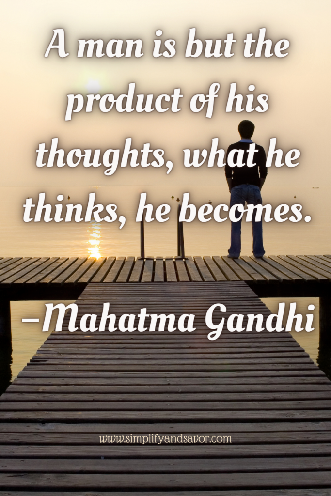This picture is of a man standing on a dock looking out at the water. The quote is A man is but the product of his thoughts, what he thinks, he becomes. Quote by Mahatma Gandhi.