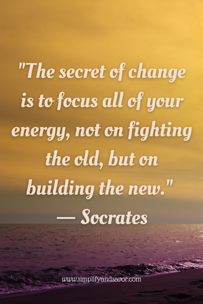 This quote from Socrates is placed over an image of a beach with the ending of a sunset reflecting on the water. The quote is: The secret of change is to focus all of your energy, not on fighting the old, but on building the new.