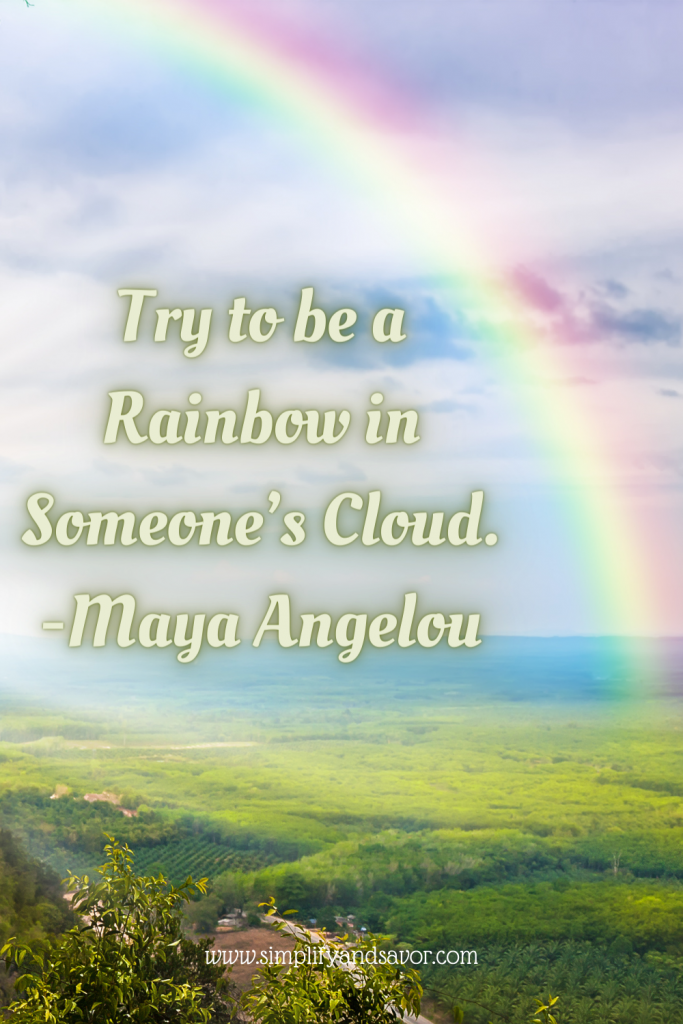 This is a rainbow over a field, and the quote says Try to be a Rainbow in someone's cloud by Maya Angelou