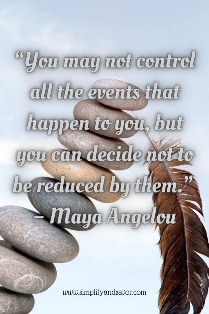 In this photo we have a stack of river rocks that are starting to tip over, and a feather standing up holding the rocks from falling with the quote: You may not control all the events that happen to you, but you can decide not to be reduced by them. Quote by Maya Angelou